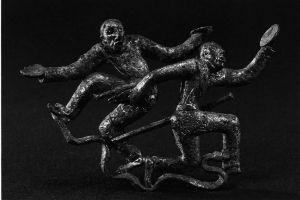 古滇国的出土文物——盘舞铜扣饰